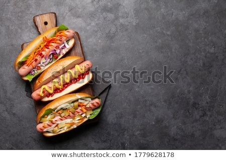 Various hot dog with vegetables, lettuce and condiments Stock photo © karandaev