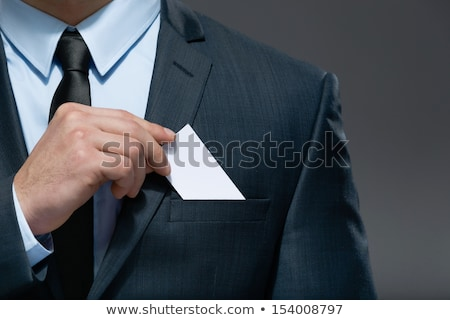 The businessman in a suit and a tie. Hand with a white card . Stock photo © cookelma