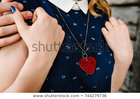 Elegant man closing the necklace of his wife Stock photo © photography33