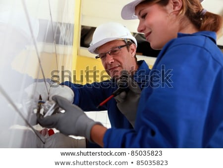 a young female electrician and a mature electrician Stock photo © photography33