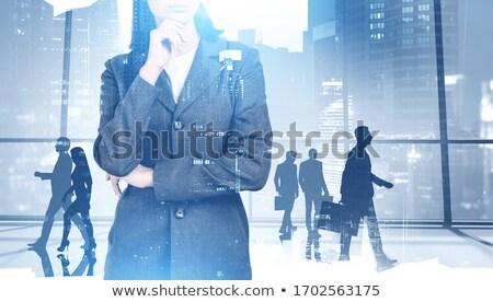 tükröződő · figyelmes · üzletasszony · sok · lehetőségek · nő - stock fotó © dolgachov