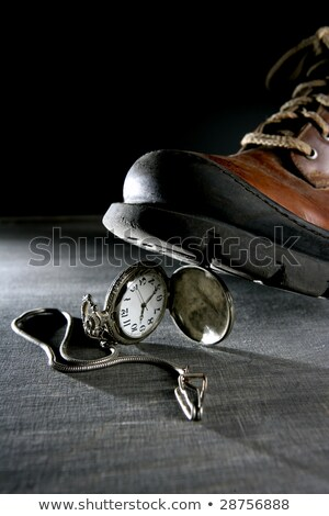 Boot treading an old pocket silver watch Stock photo © lunamarina