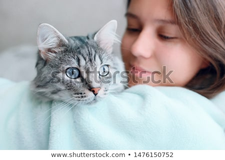 csinos · fiatal · nő · macska · padló · otthon · mosoly - stock fotó © HASLOO