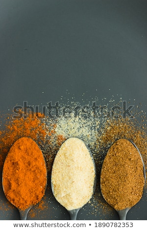 Three Spoonfuls of seasonings Stock photo © Digifoodstock