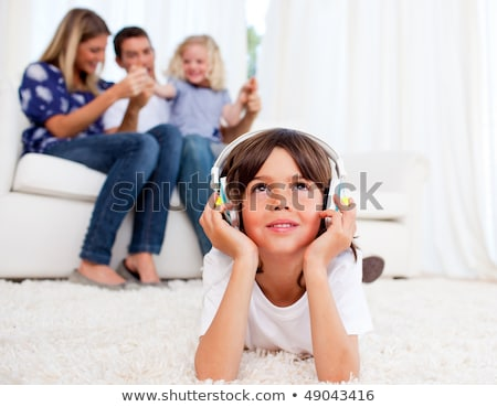 adorable little boy at home listening to music with headset on h stock photo © zurijeta