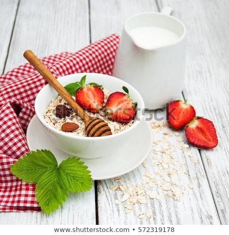 Granola tej gyümölcs tányér friss bogyós gyümölcs Stock fotó © Digifoodstock