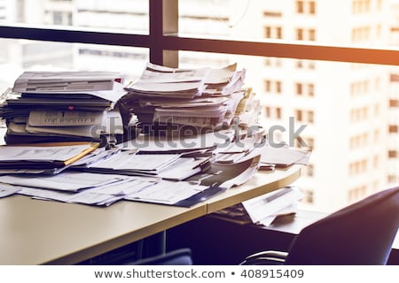 Desk and stacks of paper in office Stock photo © IS2