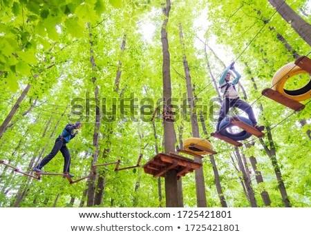 Człowiek kobieta wspinaczki liny sportu lesie Zdjęcia stock © Kzenon
