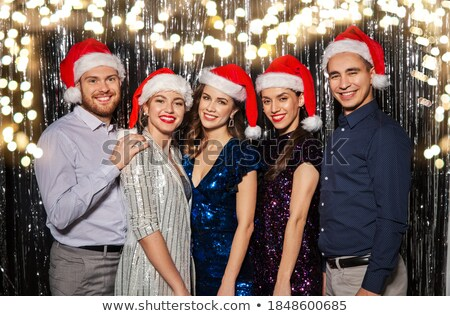 happy friends with party props over festive lights stock photo © dolgachov