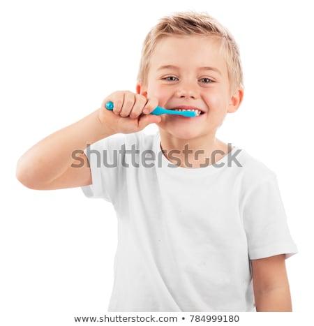 Aranyos kicsi fiú fogmosás izolált fehér Stock fotó © Lopolo