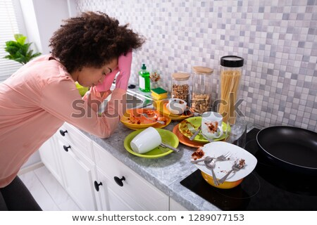 Tired Woman Leaning Near Sink With Dirty Utensils Stock photo © AndreyPopov