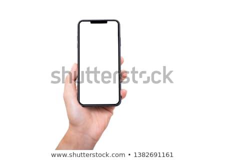 woman holds new mobile phone  Stock photo © OleksandrO