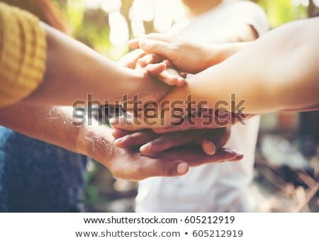 teamwork concept friends with stack of hands showing unity and teamwork top view young people put stock photo © makyzz