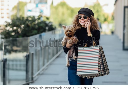 beautiful young blonde on a walk with little dog stock photo © elenabatkova