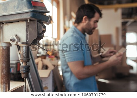 carpenter with drill casually leaning on work bench stock photo © photography33