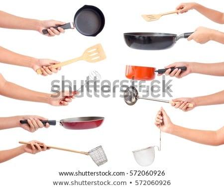 Chef holding a kitchen utensil Stock photo © bluering