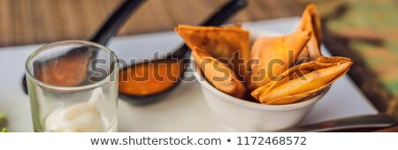Lifestyle food. The dish consists of salad, samosa and several kinds of sauces Stock photo © galitskaya