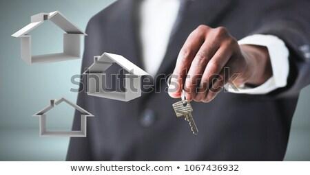Hand Holding key in front of vignette Stock photo © wavebreak_media