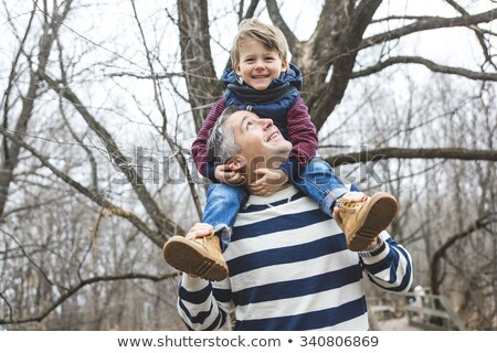 happy father and son having fun in park at the end of october Stock photo © Lopolo