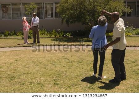 Hátsó nézet idős pár áll kéz park öregek otthona Stock fotó © wavebreak_media