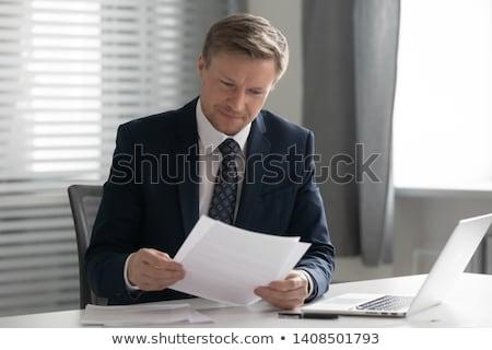 ビジネスマン 座って デスク 書類 ハンサム ビジネス ストックフォト © ra2studio