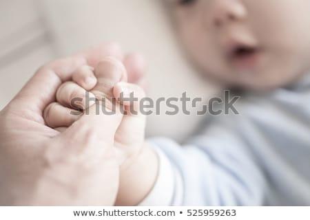 Recém-nascido bebê pai mão menina Foto stock © Burchenko