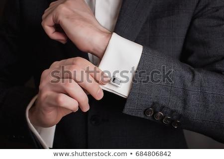 elegant business man fixing his bowtie Stock photo © feedough