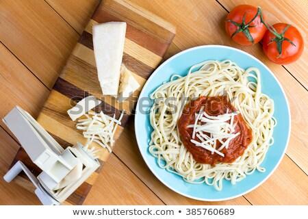 Pasta press with gruyere cheese and spaghetti Stock photo © ozgur