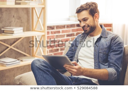relaxed man using a tablet at home Stock photo © Giulio_Fornasar