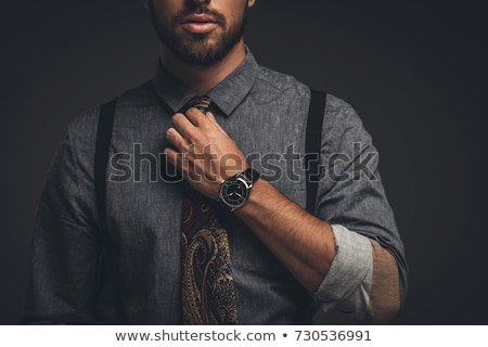 A man adjusting his tie Stock photo © IS2