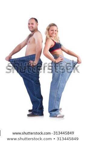 Two fit young woman in loose jeans Stock photo © ruslanshramko
