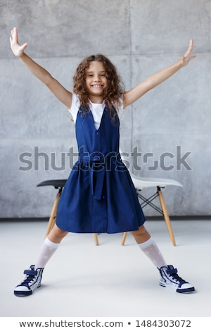 Portrait of a cute 7 years old girl Isolated over white background with headphone Stock photo © Lopolo