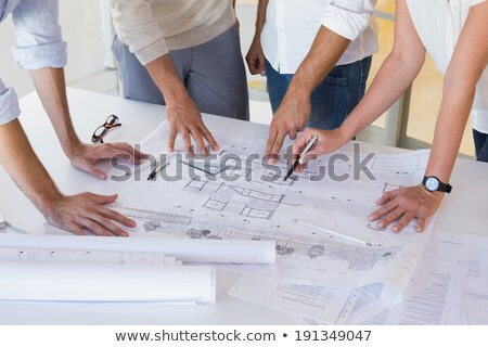 High angle view of Caucasian businesswoman interacting with Caucasian businessman speaking in front  Stock photo © wavebreak_media