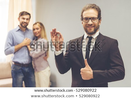 Smart woman giving contract to a man Stock photo © photography33