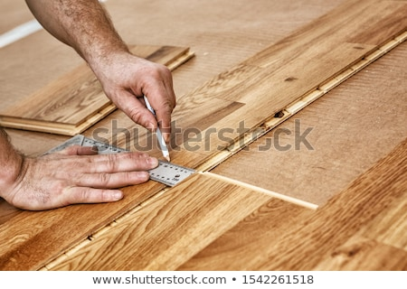 Man at home laying wooden flooring Stock photo © photography33