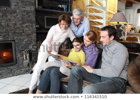 Family gathered together looking at photographs Stock photo © photography33