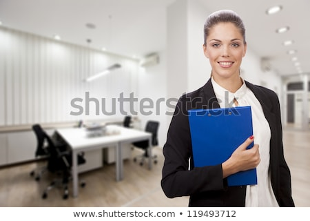 A cute businesswoman holding a folder. Stock photo © photography33