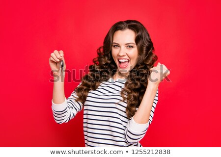 brunette girl with  key Stock photo © OleksandrO