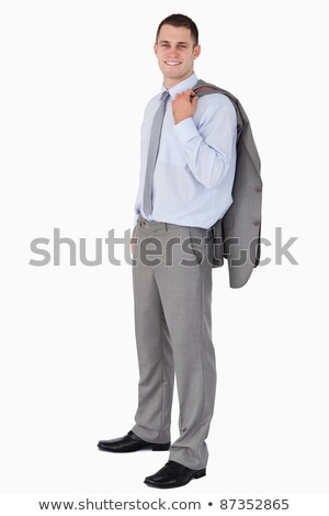 Businessman with his coat tossed over his shoulder on white background Stock photo © wavebreak_media