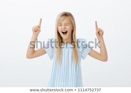 dostça · gülen · genç · kadın · işaret · yukarı - stok fotoğraf © pablocalvog