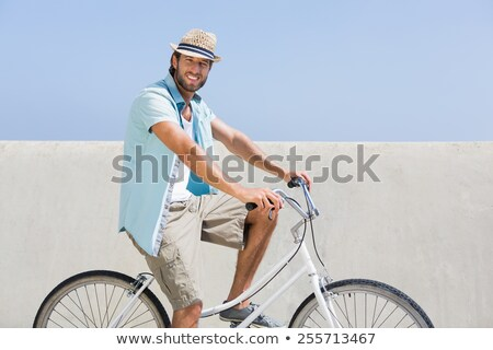 man with bicycle looking at skies Stock photo © chesterf