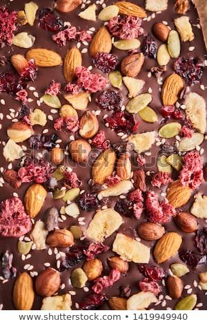 Törött csokoládé szelet fa asztal szelektív fókusz étel csokoládé Stock fotó © nessokv
