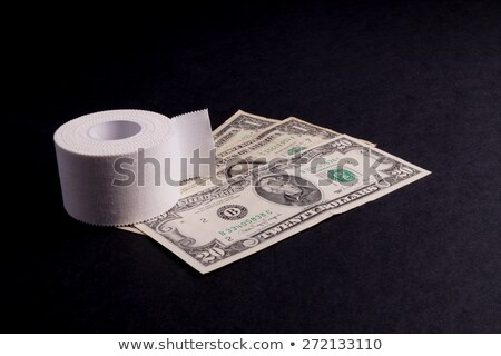 Therapeutic self adhesive tape and Money Stock photo © Klinker
