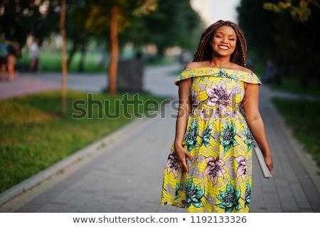 happy girl with dreadlocks hair posing Stock photo © goce