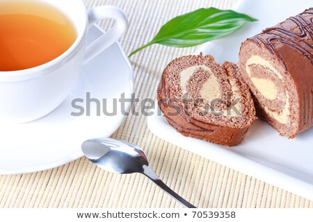 Swiss roll with condensed milk cream and a green leaf Stock photo © ancher