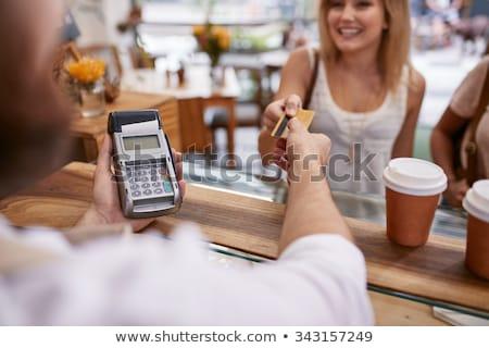 close up of man giving credit card to waiter Stock photo © dolgachov