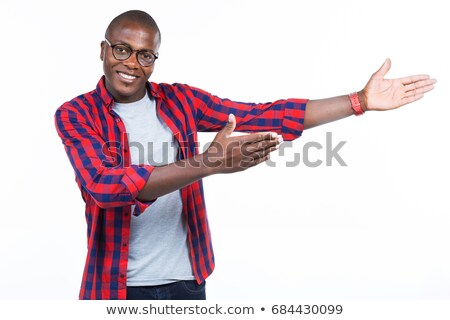 smiling casual man standing and presenting to side Stock photo © feedough