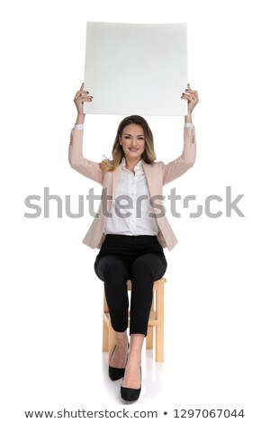 attractive smart casual woman holds white board in the air Stock photo © feedough