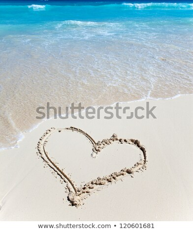 picture of heart in sand on summer beach stock photo © dolgachov