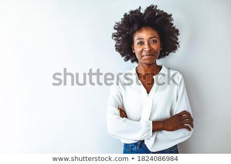 Young beautiful businesswoman with toothy smile crossing arms on chest Stock photo © pressmaster